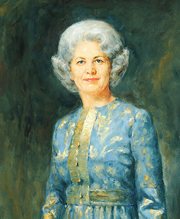 A painted portrait by Cloy Paulson Kent of Barbara Bradshaw Smith against a green and blue background, wearing a blue dress with buttons down the front.