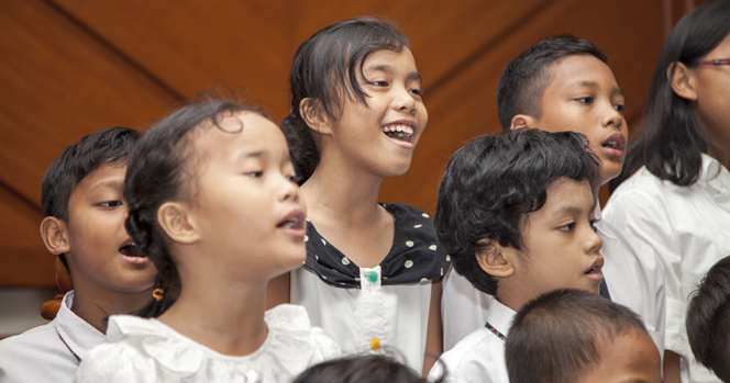 A photo of children singing in a Primary program.