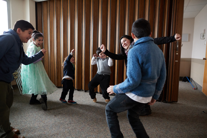 A Primary teacher in Argentina dances with the children in her class.