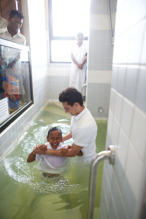 A young boy being baptized in a Church building in Madagascar.