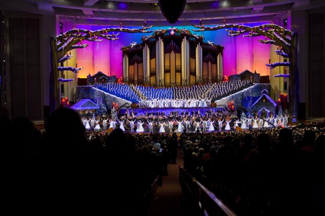 A scene from the 2010 Christmas concert with the Mormon Tabernacle Choir singing in the back and dancers in the front.