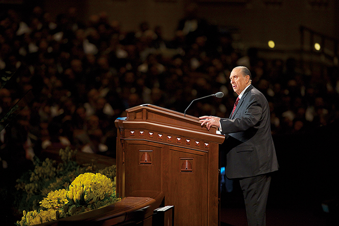 Thomas S. Monson standing at the pulpit and speaking to the congregation during general conference.