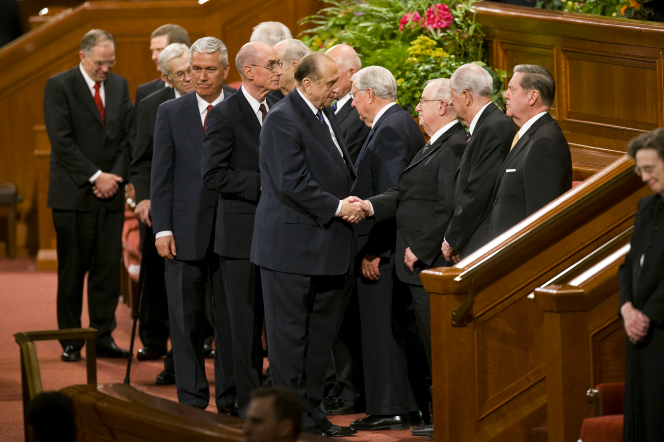 Thomas S. Monson shakes the Apostles' hands as they exit the Conference Center.