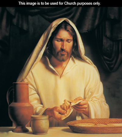 A painting of Jesus Christ wearing a white robe and pulling a small loaf of bread to pieces.
