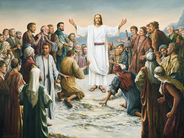 Jesus Christ in white robes and a red sash stands in the midst of a large group with His wounded hands outstretched.