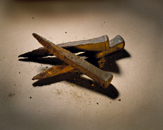 Three old rusted iron nails of the type that would have been used to crucify Christ.