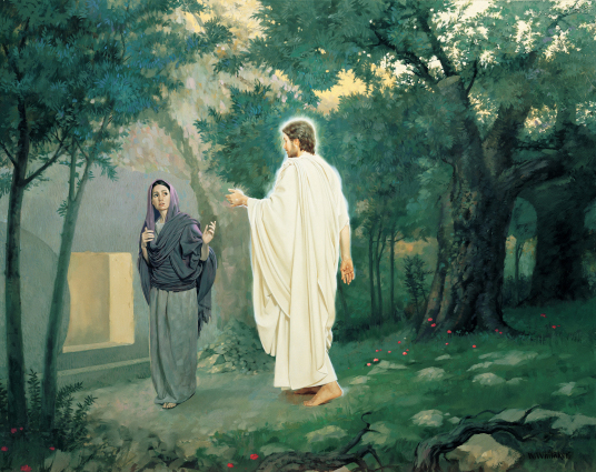 The resurrected Christ in white robes walks through trees to talk to Mary, who is standing outside of the empty tomb.
