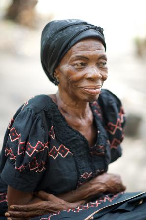 An informal portrait of an elderly woman in a black dress.