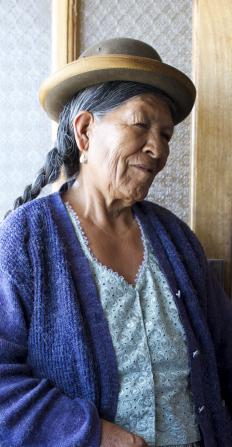 An informal portrait of an elderly woman wearing a hat.