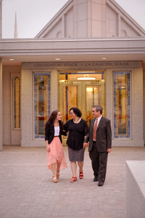 A daughter and her parents dressed in church clothes, walking out of the Buenos Aires Argentina Temple.