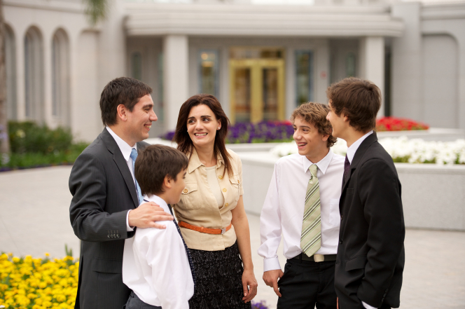 A mother, father, and three sons dressed in their church clothes, standing outside the Buenos Aires Argentina Temple.