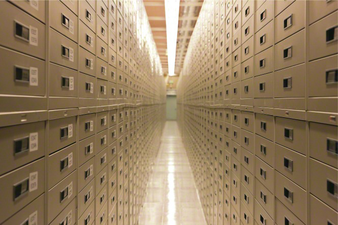 A view down the aisle, with cabinets on each side filled with microfiche, at the Granite Mountain Records Vault.