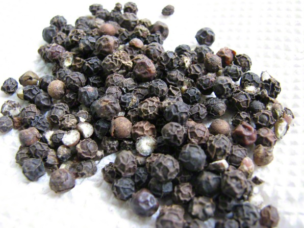 A bunch of peppercorns on a table.