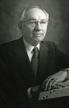 A black-and-white half-length portrait of President Gordon B. Hinckley.