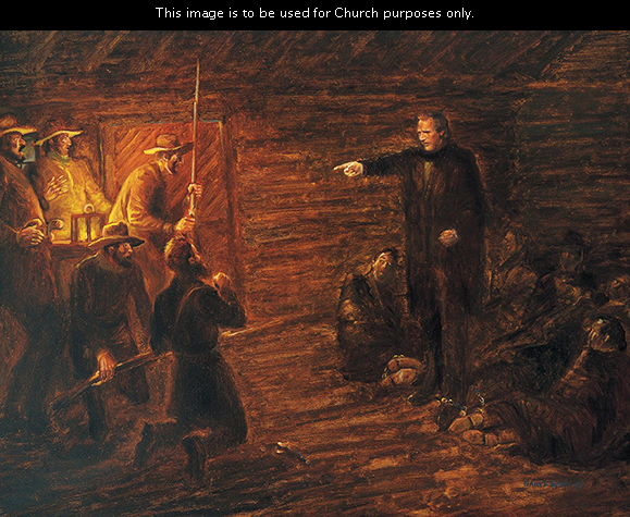 A painting by Gary E. Smith of Joseph Smith standing and pointing at the guards at the Richmond jail while chastising them.