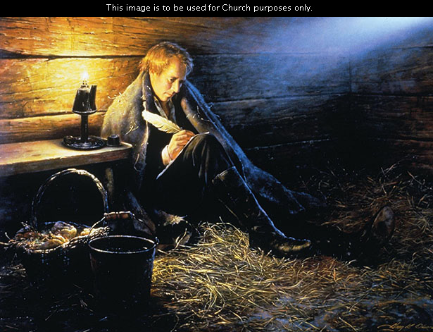 A painting by Greg K. Olsen depicting Joseph Smith sitting on the floor on some straw in Liberty Jail, writing on a piece of paper, with sunlight shinning on him.