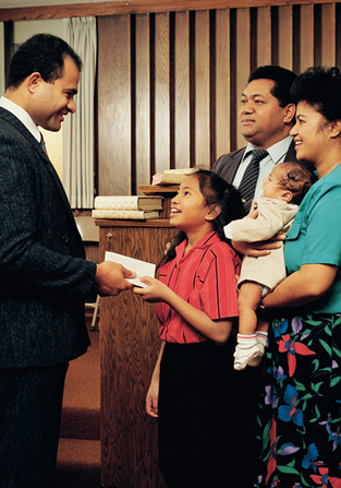 A photograph by Steve Bunderson depicting a young girl at church standing next to her parents and handing a tithing envelope to her bishop.