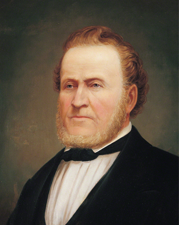 A painted portrait by George Martin Ottinger of Brigham Young in a dark suit.