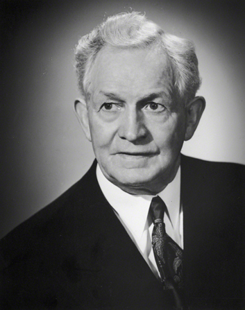 A black-and-white photograph of David O. McKay in a dark suit against a plain background.