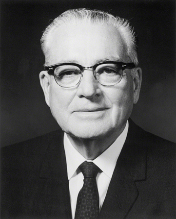 A portrait photograph of Harold B. Lee in a dark suit and tie.