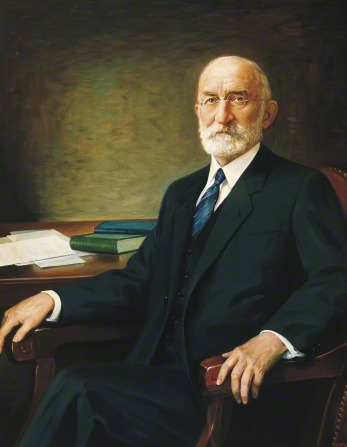 A portrait by C. J. Fox of President Heber J. Grant in a black suit and blue tie sitting in a chair.