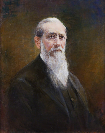 A painted portrait by John Willard Clawson of Joseph F. Smith in a dark suit with a long beard and round glasses.