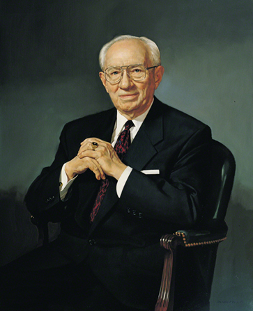 A painted portrait by William F. Whitaker Jr. of Gordon B. Hinckley in a dark suit and red tie, sitting in a black leather chair.