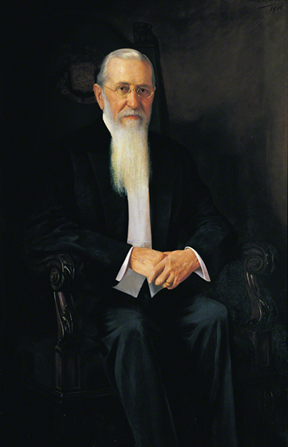 A painted portrait of Joseph F. Smith sitting in a large black chair, by A. Salzbrenner.