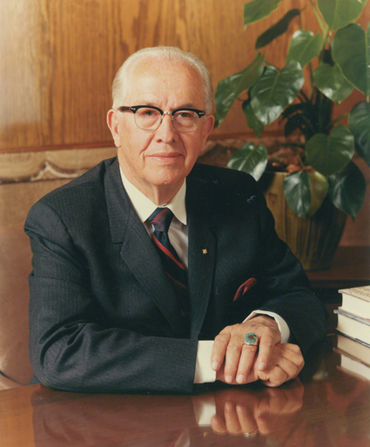 A portrait photograph by Eldon Keith Linschoten of Ezra Taft Benson sitting at a table.