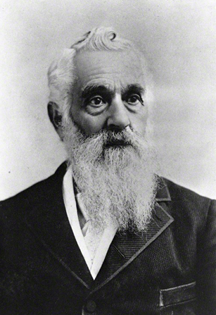 A portrait photograph of Lorenzo Snow with a long white beard, wearing a dark suit.