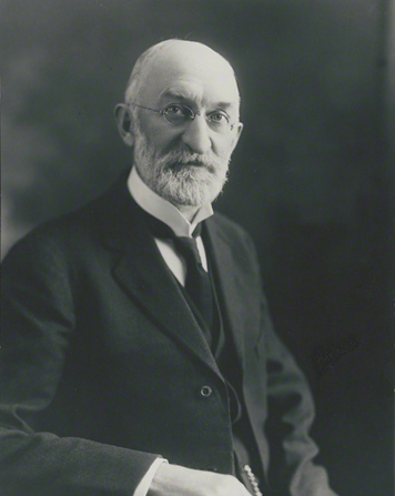 A portrait photograph by the Hartsook Photo Studio of Heber J. Grant in a dark suit and tie.