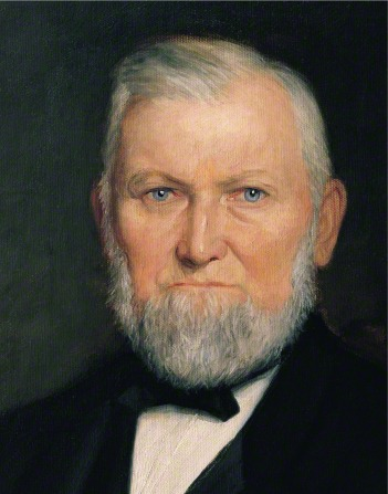 A painted portrait by H. E. Peterson of Wilford Woodruff with a short white beard, wearing a black suit.