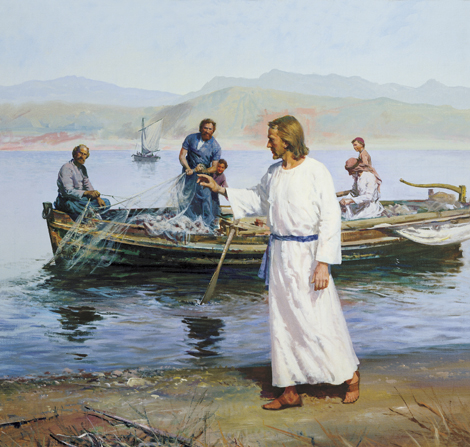 Jesus Christus in a white robe, walking along the banks of the sea and calling out to a group of fishermen, who are pulling their nets into their boat.