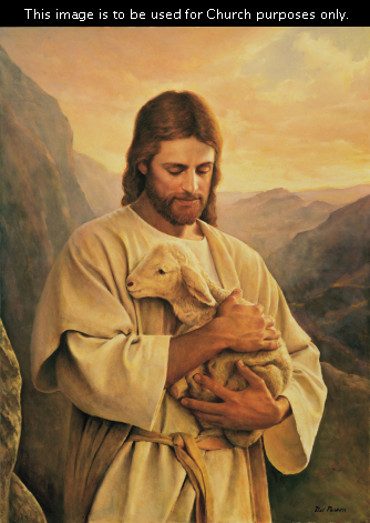 Christ in white robes, standing in a mountain scene, holding a small white lamb in both arms.