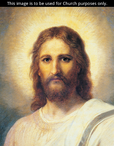 A portrait of Christ in white robes, with bright light around His head, looking out toward the viewer.