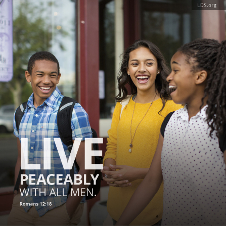 "A group of youth laughing, with a quote from Romans 12:18: ""Live peaceably with all men."""