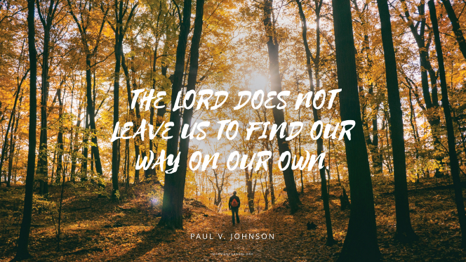 "A man standing in a forest in autumn, with a quote by Elder Paul V. Johnson: ""The Lord does not leave us to find our way on our own."""