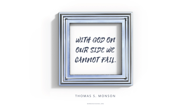 "A silver frame with a quote by President Thomas S. Monson: ""With God on our side we cannot fail."""