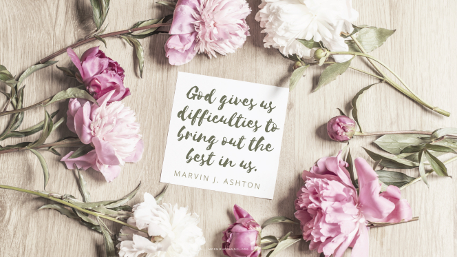 "Pink flowers arranged around a note with a quote by Elder Marvin J. Ashton: ""God gives us difficulties to bring out the best in us."""