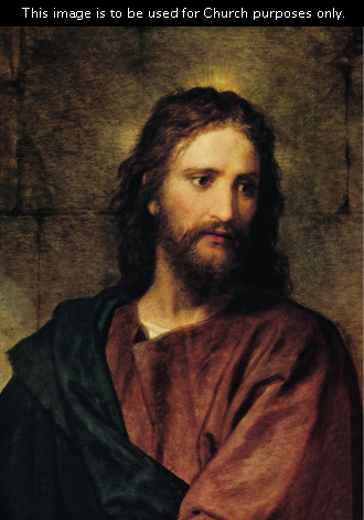 A portrait of Christ in red and black robes, standing in front of a stone wall and glancing to the side, with subtle rays of light around His head.