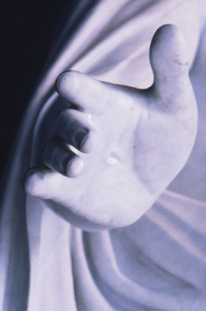 A detail photograph of the palm of the hand and nail mark on the Christus statue on Temple Square in Salt Lake City.