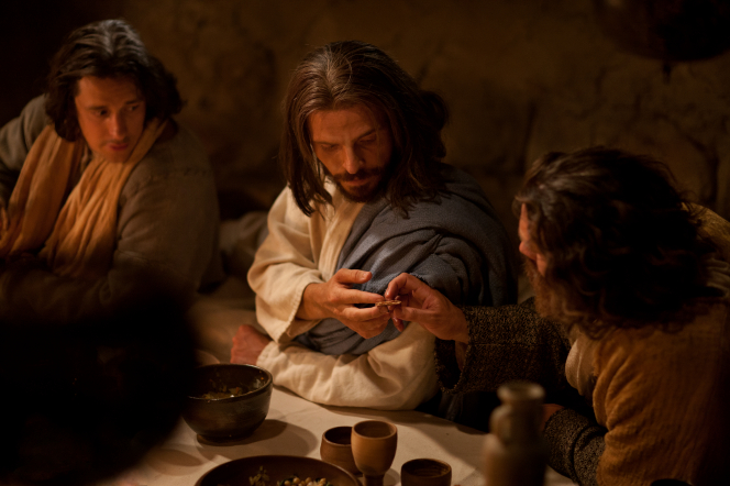 John 13:1–37, Jesus blesses bread and passes it to Judas