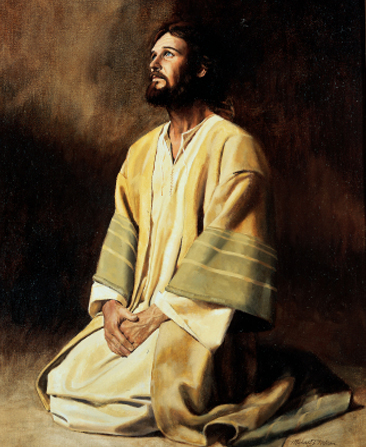 Christ in white, yellow, and green robes, kneeling with hands folded, looking upward, against a plain background.