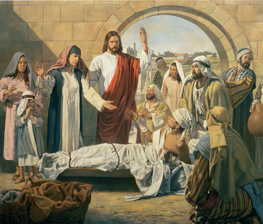 Jesus Christ in white and red robes, raising His arm to bring a young man back to life while his family and friends watch.