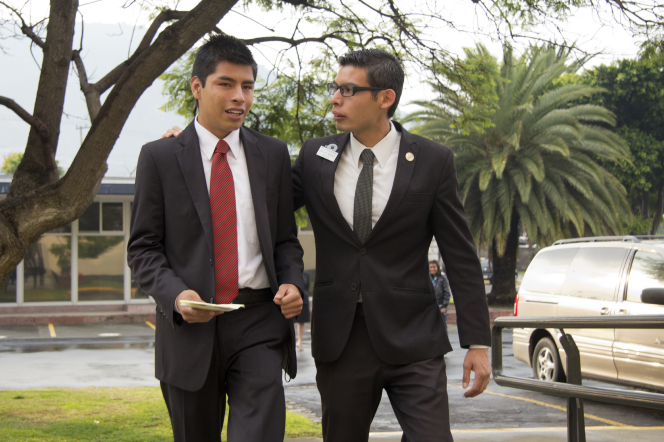 An elder missionary puts his arm around another elder missionary's shoulders to welcome him to the MTC in Mexico City.