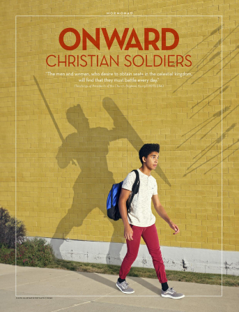 A boy walks along a sidewalk, wearing a blue backpack. The shadow he casts on the wall depicts him armed for battle, fending off a storm of arrows.