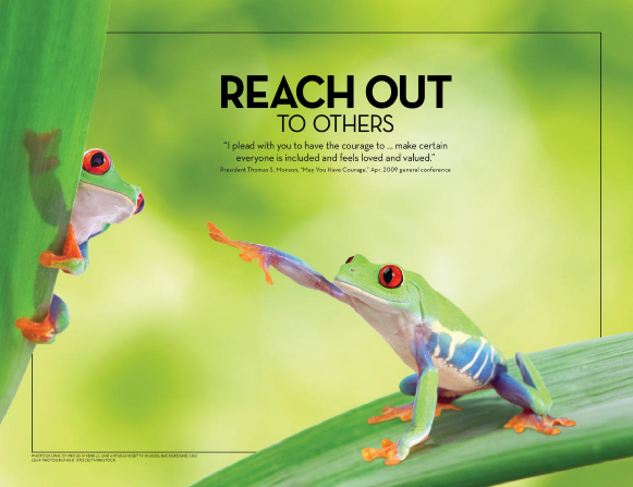 A brightly-colored tree frog reaches out to another frog that clings to a leaf nearby.
