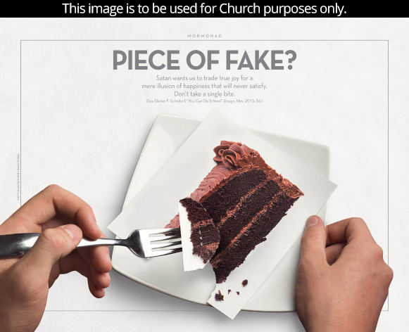 A fork holds a piece of chocolate cake that is actually only paper rather than real cake.