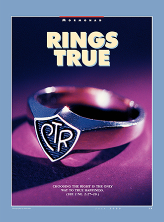 "A photograph of a CTR ring with a silver band lying on a purple surface, paired with the words ""Rings True."""