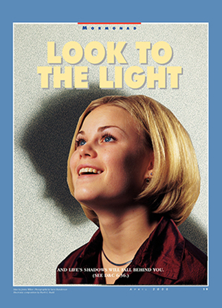 "A conceptual photograph of a girl smiling and looking up with her shadow looking down in the background, paired with the words ""Look to the Light."""